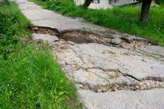Estrada quebrada Fotografia de Stock