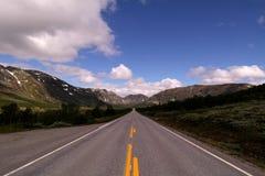 Estrada reta longa Fotos de Stock
