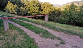 Estrada rural com uma barreira do pedágio Fotografia de Stock Royalty Free