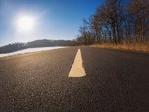 Estrada só nas montanhas invernal Foto de Stock