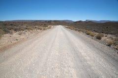 Estrada seca e rochosa do cascalho Fotos de Stock