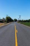 Estrada secundária em uma tarde ensolarada fotos de stock royalty free