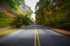 Estrada secundária no outono com borrão de movimento fotos de stock royalty free