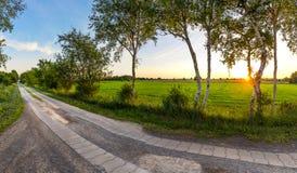 Estrada secundária no por do sol fotos de stock royalty free