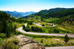 Estrada serpentina nas montanhas Fotos de Stock Royalty Free