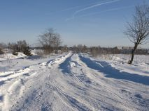 Estrada Snow-covered do inverno Fotos de Stock Royalty Free