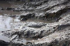 Estrada suja com lama Imagens de Stock