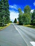 Estrada Tainionkoskentie ao norte, Imatra, Finlandia imagem de stock