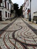 Estrada telhada mosaico em St Lazarus District de Macau China foto de stock