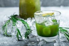 Estragon lemonade. Concept refreshing summer drinks. Fresh cool lemonade tarragon with ice and citrus slices. Estragon lemonade. Concept refreshing summer stock photos