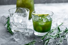 Estragon lemonade. Concept refreshing summer drinks. Fresh cool lemonade tarragon with ice and citrus slices. Estragon lemonade. Concept refreshing summer royalty free stock photo