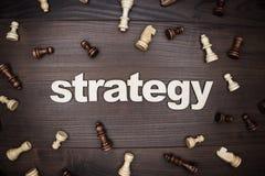 Estratégia da palavra no fundo de madeira Imagem de Stock