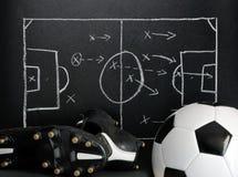 Estrategia del fútbol en una pizarra Fotografía de archivo libre de regalías