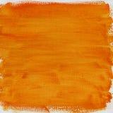 Estratto arancione dell'acquerello con struttura della tela di canapa Fotografia Stock