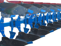 Estratto blu moderno di fila dell'aratro del trattore isolato sopra bianco Fotografia Stock