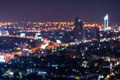 Estratto, bokeh della sfuocatura della luce di paesaggio urbano di notte Immagini Stock