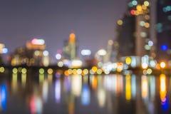 Estratto, bokeh della sfuocatura della luce di paesaggio urbano di notte, fondo defocused Fotografie Stock Libere da Diritti