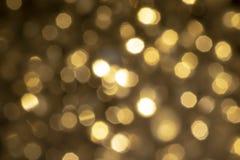 Estratto del bokeh dell'oro di luce fotografie stock