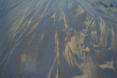 Estratto del primo piano della sabbia della spiaggia con struttura di colore immagine stock libera da diritti