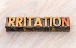 Estratto di parola di irritazione nel tipo di legno Immagine Stock Libera da Diritti