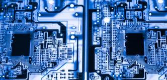Estratto, fine su del fondo del computer elettronico di mainboard bordo di logica, scheda madre del CPU, consiglio principale, bo immagine stock