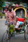Estrattore di Rikshaw in Dacca Fotografie Stock