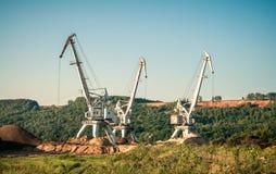 Estrazione mineraria della sabbia delle gru Fotografie Stock Libere da Diritti