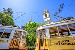 Estrela Basilica and Tram 28. Lisbon, Portugal - August 27, 2017: two yellow historic Tram 28 in front of famous baroque and neoclassical Estrela basilica stock images