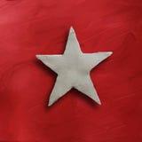 Estrela branca no fundo vermelho Imagens de Stock Royalty Free