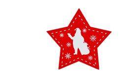 Estrela cinco-aguçado vermelha isolada com a silhueta branca de Santa imagem de stock