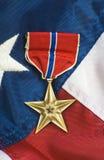 Estrela de bronze na bandeira dos EUA Fotografia de Stock Royalty Free