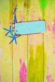 Estrela do mar e espaço azuis no amarelo Fotografia de Stock