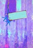 Estrela do mar e espaço azuis no roxo Fotografia de Stock
