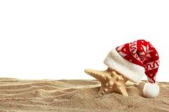 Estrela do mar em um tampão de ano novo que está na areia imagens de stock