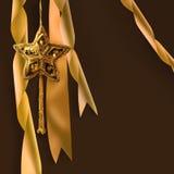 Estrela do Natal do ouro com fitas Imagens de Stock Royalty Free