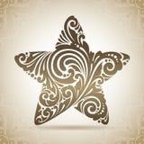 Estrela do ornamental do vintage Ícone decorativo em um fundo com teste padrão Imagem de Stock