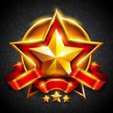 Estrela do ouro com uma fita vermelha Foto de Stock