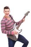 Estrela do rock com uma guitarra elétrica Foto de Stock