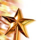 Estrela dourada do ano novo no movimento no bokeh brilhante Imagens de Stock Royalty Free