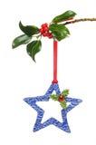 Estrela e azevinho cerâmicos Fotografia de Stock