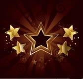 Estrela em um fundo marrom Fotos de Stock