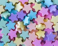 Estrelas da tabuleta do leite Fotos de Stock