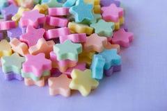 Estrelas da tabuleta do leite Fotografia de Stock