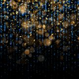 Estrelas de brilho do Natal dourado de incandescência mágico dourado efervescente da poeira e do ano novo em escuro - fundo azul  ilustração royalty free