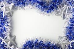 Estrelas de prata e ouropel azul Foto de Stock Royalty Free