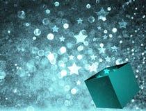 Estrelas do Natal que saem de uma caixa de presente Fotos de Stock