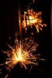 Estrelas e chuveirinhos dos fogos-de-artifício Imagens de Stock