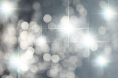 Estrelas e fundo de prata de Bokeh Foto de Stock Royalty Free