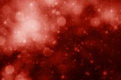 Estrelas e fundo vermelhos do Natal de Bokeh Imagens de Stock Royalty Free