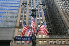 Estrelas e listras na 42nd rua Fotos de Stock